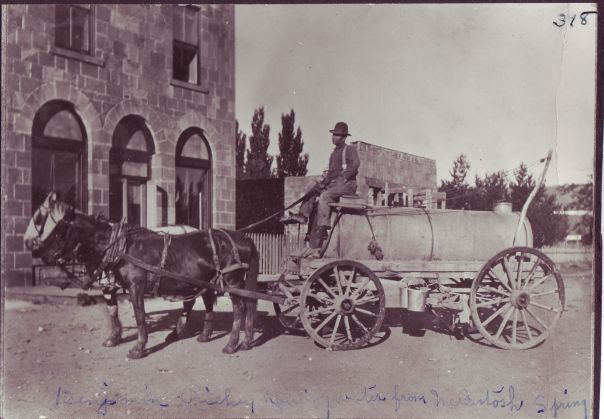 Water Truck - Benjamin Richen hauling drnking water from McIntosh Spring, delivered to residents for 5 cents a bucket.